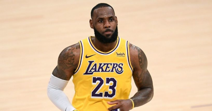 LeBron James #23 of the Los Angeles Lakers reacts after his three-pointer in double overtime to lead the Lakers to a 135-129 win over the Detroit Pistons at Staples Center on Feb. 6, 2021, in Los Angeles, California.