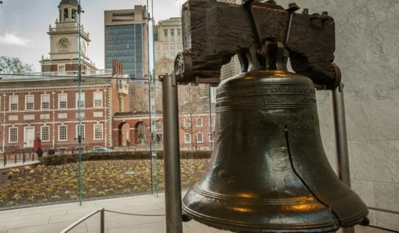 The Liberty Bell and Independence Hall in the background are seen at Philadelphia's Independence National Historic Site in the photo above.