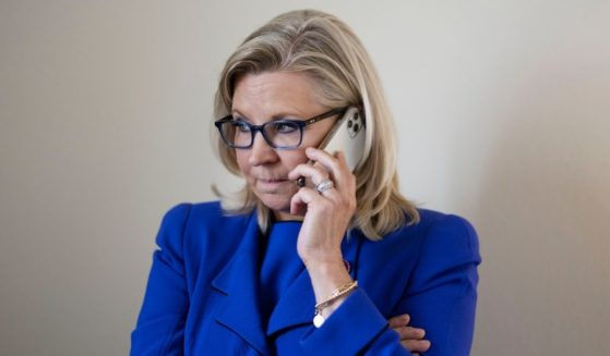 Republican Rep. Liz Cheney of Wyoming is seen on the phone in her office after losing her GOP leadership role.
