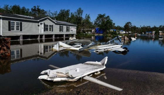 Houses are surrounded by flood waters after Hurricane Delta passed through the area on Oct. 10, 2020, near Lake Charles, Louisiana.