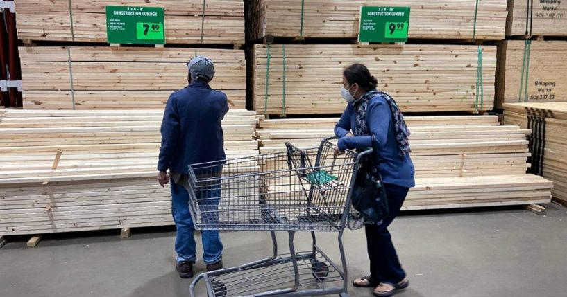 Customers look at stacks of lumber at a home center in Chicago on April 5.