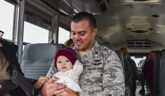 Eliza rides with her dad Maj. Matthew Lohmeier, 460th Space Wing executive officer, on her way to visit the Mission Control Station during Team Buckley Spouse and Family Day Center on Dec. 22, 2016. The event consisted of families given access to see the 460th Space Wing mission up close, with demonstrations from the operators, Defenders, and firefighters.