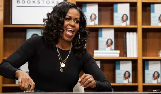 "Former U.S. first lady Michelle Obama appears at a book signing on the first anniversary of the launch of her memoir ""Becoming"" at the Politics and Prose bookstore in Washington, D.C., on Nov. 18, 2019."