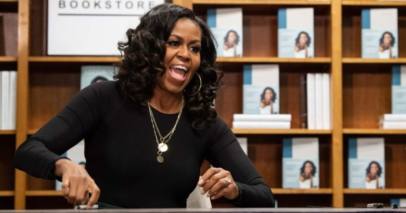 """Former U.S. first lady Michelle Obama appears at a book signing on the first anniversary of the launch of her memoir """"Becoming"""" at the Politics and Prose bookstore in Washington, D.C., on Nov. 18, 2019."""