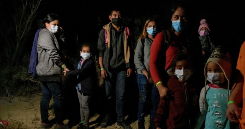 Migrants from Central America, who arrived illegally from Mexico to the U.S. to seek asylum, rest after arriving on an inflatable boat across the Rio Grande river at the border city of Roma on March 29, 2021.