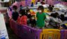 Young unaccompanied migrants, ages 3-9, watch TV inside a playpen at the Donna Department of Homeland Security holding facility, the main detention center for unaccompanied children in the Rio Grande Valley in Donna, Texas, on March 30, 2021.