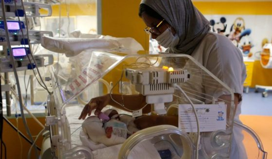 A Moroccan nurse takes care of one of the nine babies protected in an incubator at the maternity ward of the private clinic of Ain Borja in Casablanca, Morocco, on Wednesday.