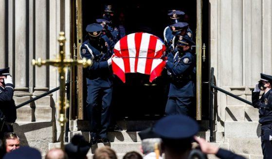 Police officers carry the body of slain Boulder police officer Eric Talley to a hearse after a funeral mass at the Cathedral Basilica of the Immaculate Conception in Denver on March 29.