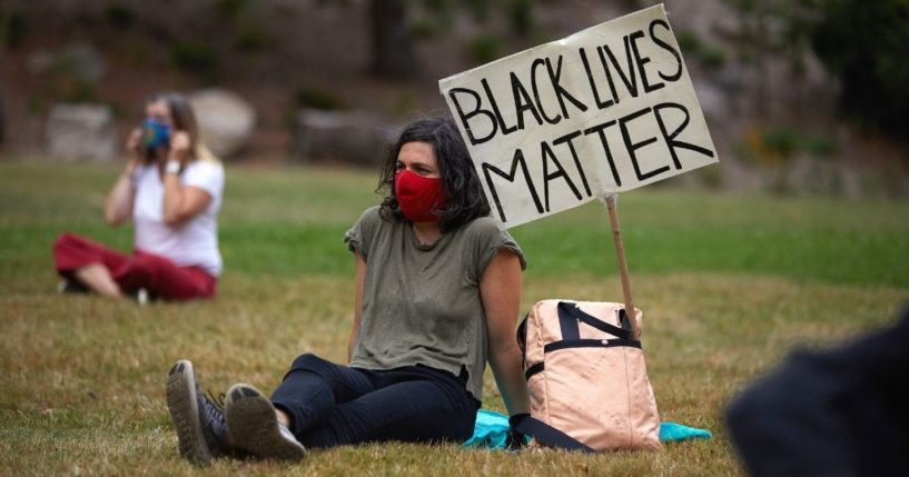 People wear masks as they gather at Lents Park in Portland, Oregon, on Sept. 5, 2020, to mark the 100th day of protests in the city against racism and police brutality.