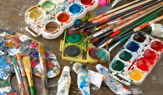 Paints and brushes are pictured in the stock image above.