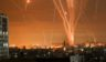Rockets light up the night sky as they are fired towards Israel from Beit Lahia in the northern Gaza Strip on Friday local time.