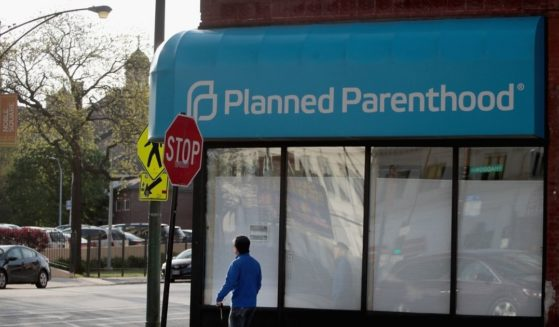 A sign hangs over the front of a Planned Parenthood clinic on May 18, 2018, in Chicago.