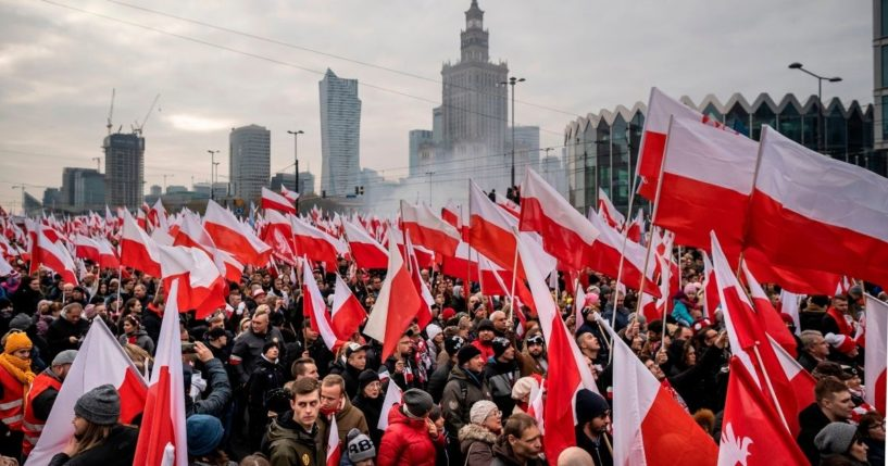 People wave national flags during a march to mark Poland's National Independence Day on Nov. 11, 2019, in Warsaw.