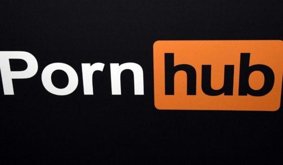 A Pornhub logo is displayed at the company's booth at the 2018 AVN Adult Entertainment Expo at the Hard Rock Hotel & Casino on Jan. 24, 2018, in Las Vegas.