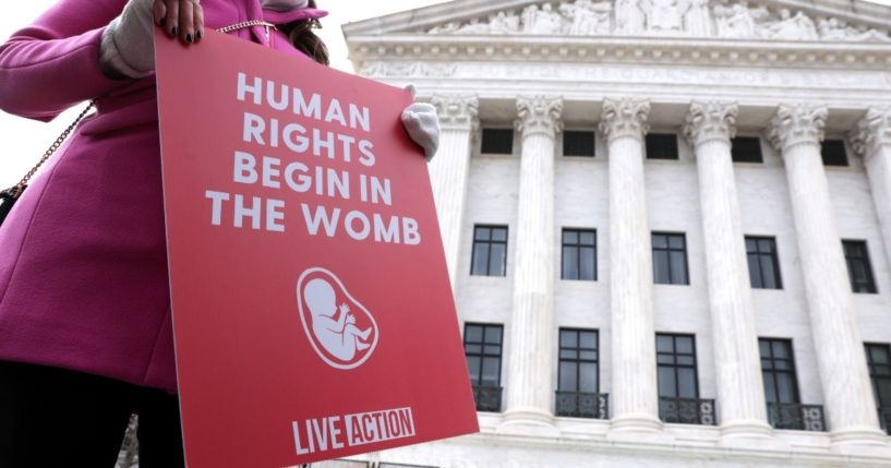 A pro-life activist holds a sign outside the U.S. Supreme Court during the 48th annual March for Life Jan. 29 in Washington, D.C.