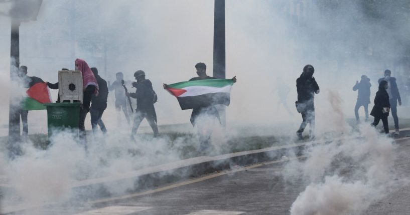 Smoke fills the air as pro-Palestinian demonstrators riot in Paris on May 15, 2021.