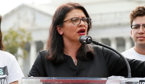 Democratic Rep. Rashida Tlaib of Michigan, center, speaks on the grounds of the U.S. Capitol on Sept. 26, 2019, in Washington, D.C.