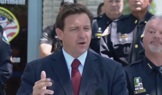 Standing among law enforcement officers, Republican Gov. Ron DeSantis of Florida said Wednesday that the state will provide $1,000 bonuses to all police officers, firefighters and paramedics in the state.