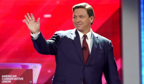 Republican Florida Gov. Ron DeSantis waves to supporters at the Conservative Political Action Conference (CPAC) on Feb. 26, 2021, in Orlando.