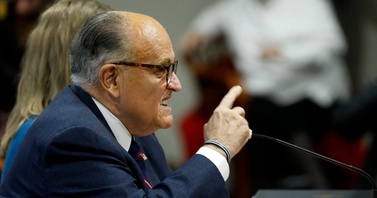 Rudy Giuliani gestures as he speaks during an appearance before the Michigan House Oversight Committee in Lansing, Michigan, on Dec. 2, 2020.