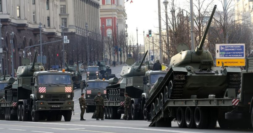 The Russian military drives heavy trucks carrying Soviet T-34 tanks during the first city rehearsals of the Victory Day military parade on April 29, 2021, in Moscow, Russia.