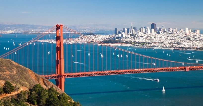 A panorama shows San Francisco and the Golden Gate Bridge.