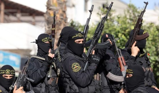 Fighters with the Saraya al-Quds Brigades, the armed wing of Palestinian Islamic Jihad, parade with their weapons in the streets of Gaza City during a rally on Saturday, more than a week after a ceasefire brought an end to 11 days of hostilities between Israel and Hamas.