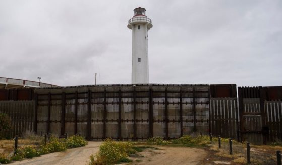 The Faro de Playas de Tijuana lighthouse stands behind the border wall where it ends in the Pacific Ocean along the U.S.-Mexico border between San Diego and Tijuana on Monday at International Friendship Park in San Diego County, California.