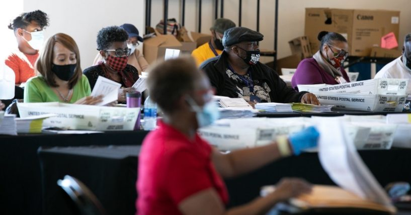 Election workers count Fulton County ballots at State Farm Arena in Atlanta on Nov. 4.