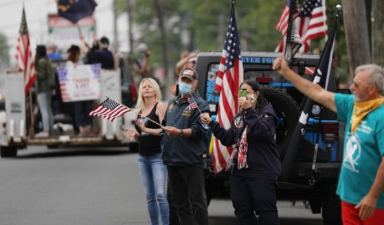 People participate in the annual Memorial Day Parade in the Staten Island borough of New York City on May 25, 2020.