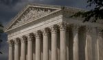 Clouds are seen above the U.S. Supreme Court building on Monday in Washington, D.C.