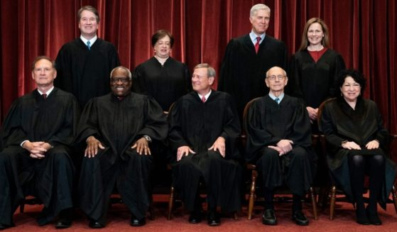 Justices pose for a group photo of the Supreme Court in Washington on April 23. Seated, from left, are Associate Justice Samuel Alito, Associate Justice Clarence Thomas, Chief Justice John Roberts, Associate Justice Stephen Breyer and Associate Justice Sonia Sotomayor. Standing, from left, are Associate Justice Brett Kavanaugh, Associate Justice Elena Kagan, Associate Justice Neil Gorsuch and Associate Justice Amy Coney Barrett.