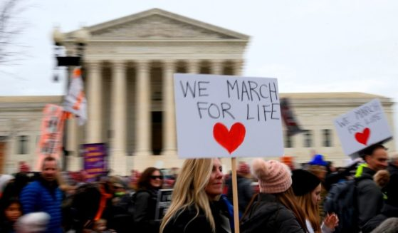 Pro-life activists rally in front of the U.S. Supreme Court building during the 47th annual March for Life in Washington on Jan. 24, 2020