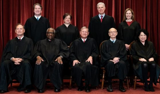 Members of the Supreme Court pose for a group photo at the Supreme Court in Washington on April 23.