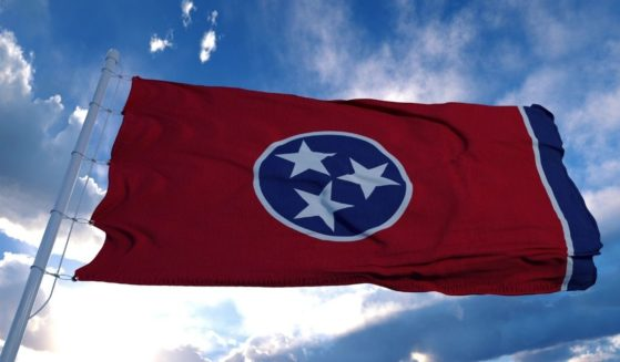 The Tennessee state flag flies in the above stock image.