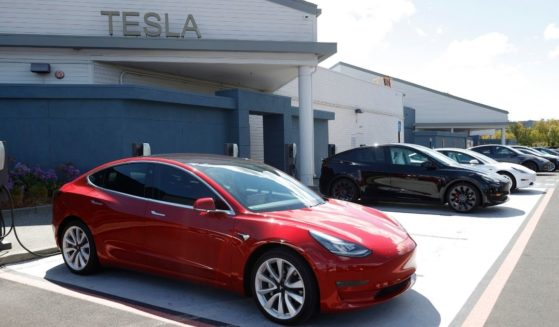Tesla cars charge at a Tesla charging station on April 26, 2021, in Corte Madera, California.