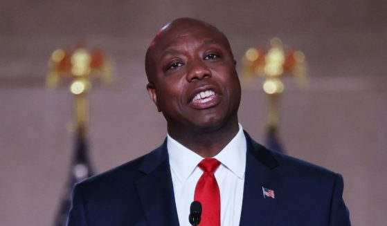 Republican Sen. Tim Scott of South Carolina stands on stage in an empty Mellon Auditorium while addressing the Republican National Convention on Aug. 24, 2020, in Washington, D.C.