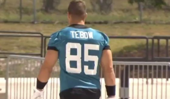 Tim Tebow's new Jacksonville Jaguars jersey has quickly become a bestselling item on NFLShop.com just one day after the former Heisman Trophy winner officially signed with the team as a tight end.