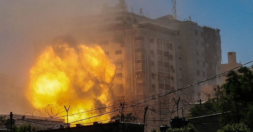 A ball of fire erupts from the Jala Tower as it is destroyed in an Israeli airstrike in Gaza City on Saturday.