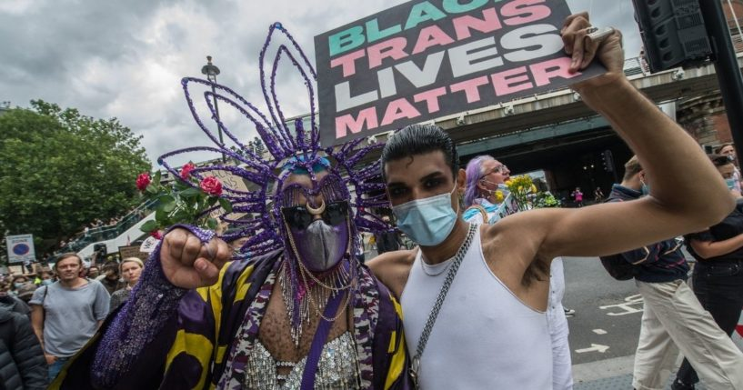 Two people react to the camera near Embankment station during a march in support of the black LGBTQ+ community on June 27, 2020, in London, England.