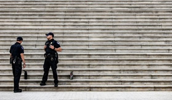Capitol Police officers stand at the bottom of the steps to the Rotunda at the US Capitol building on Capitol Hill in Washington, D.C. on April 29.