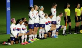United States players kneel for the American national anthem during the SheBelieves Cup at Exploria Stadium on February 18, in Orlando, Florida.