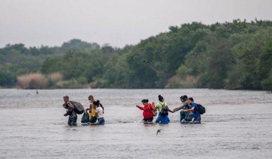Immigrants cross the Rio Grande from Mexico into Del Rio, Texas, on Monday.