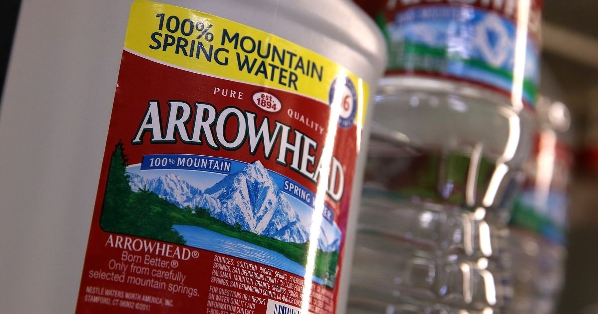 Bottles of Arrowhead water are displayed at a convenience store in San Rafael, California. The Nestlé company bottled and sold the water under the Arrowhead brand. The company recently sold its North American water arm to BlueTriton for $4.3 billion.