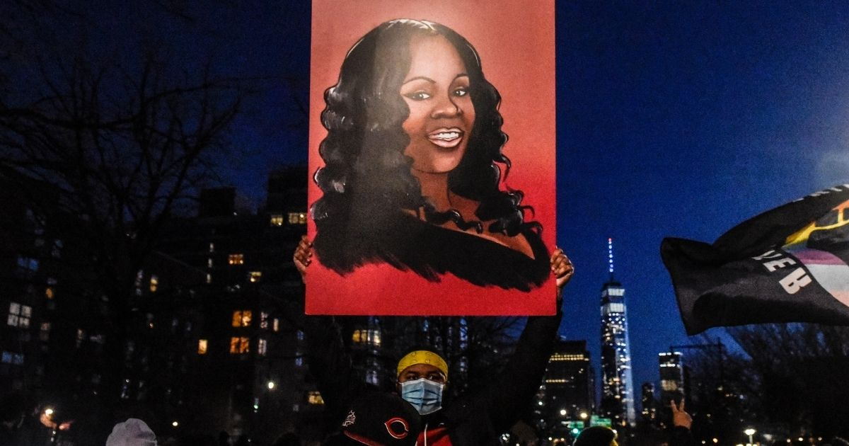 Marchers in New York City hold an image of Breonna Taylor during a March 13 demonstration.