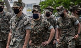 U.S. Marines prepare to receive the Moderna coronavirus vaccine at Camp Hansen in Okinawa, Japan, on April 28, 2021.