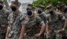 U.S. Marines prepare to receive the Moderna coronavirus vaccine at Camp Hansen in Okinawa, Japan, on April 28, 2021.