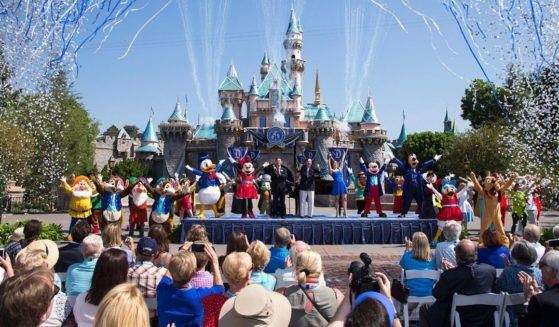 A Disney handout photo shows employees and customers celebrating the 60th anniversary of Disneyland in Anaheim, California, in 2015.