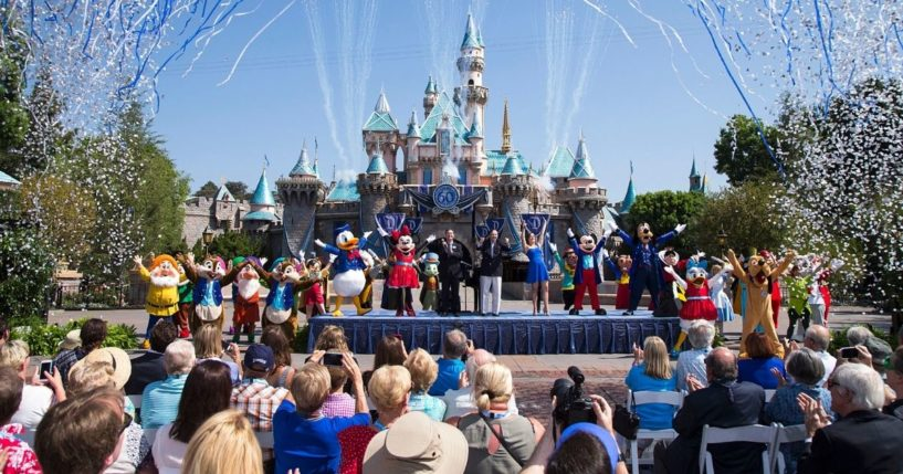 A Disney handout photo shows employees and customers celebrating the 60th anniversaryof Disneylandin Anaheim, California, in 2015.