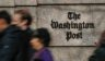 A file photo shows passersby outside the office of The Washington Post in Washington, D.C.